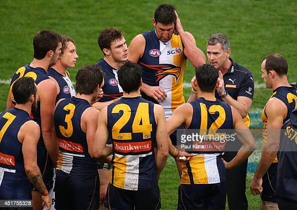 Adam Simpson coach of the Eagles addresses his players at the three quarter time break during the round 16 AFL match between the West Coast Eagles...
