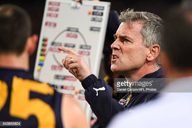 Adam Simpson coach of the Eagles addresses the team at quarter time during the 2016 AFL Round 14 match between the West Coast Eagles and the Essendon...