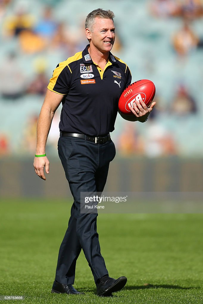 Adam Simpson, coach of the Eagles looks on as players warm up during the round six AFL match between the West Coast Eagles and the Collingwood Magpies at Domain Stadium on May 1, 2016 in Perth, Australia.
