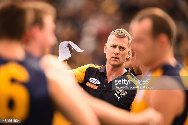 Adam Simpson coach of the West Coast Eagles addresses the team at quarter time during the 2015 AFL round 21 match between the West Coast Eagles and...