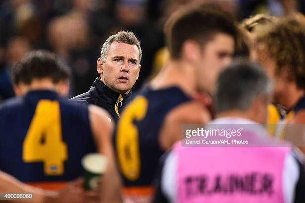 Adam Simpson coach of the West Coast Eagles addresses the team at three quarter time during the 2015 AFL Second Preliminary Final match between the...