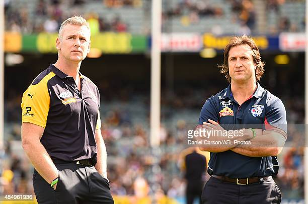 Adam Simpson coach of the West Coast Eagles and Luke Beveridge coach of the Western Bulldogs talk before the game during the 2015 AFL round 21 match...