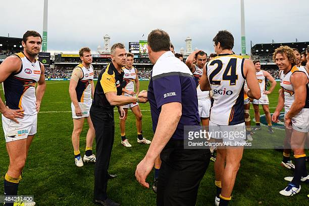 Adam Simpson coach of the West Coast Eagles and Ross Lyon coach of the Fremantle Dockers shake hands after the match during the 2015 AFL round 20...