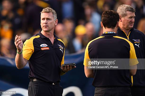 Adam Simpson coach of the West Coast Eagles considers his option at quarter time during the 2015 AFL round 17 match between the West Coast Eagles and...