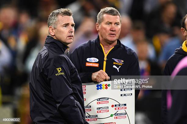 Adam Simpson coach of the West Coast Eagles considers his options at three quarter time during the 2015 AFL Second Preliminary Final match between...