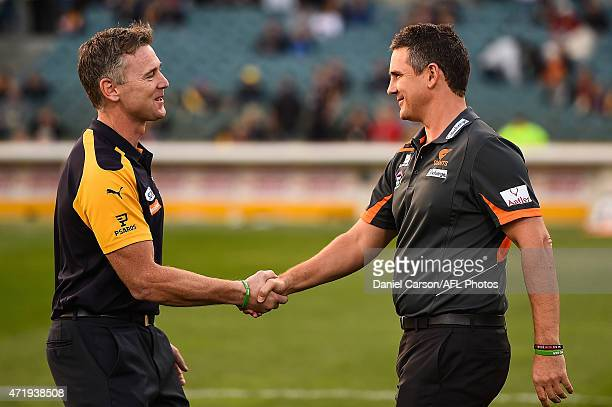Adam Simpson coach of the West Coast Eagles shakes hands with Leon Cameron coach of the Greater Western Sydney Giants at the warmup during the round...