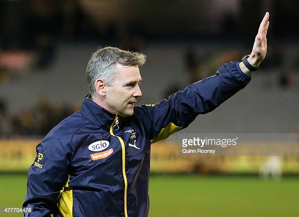 Adam Simpson the coach of the Eagles waves to the fans after winning the round 12 AFL match between the Richmond Tigers and the West Coast Eagles at...