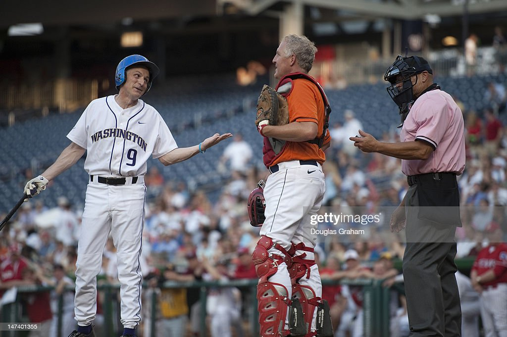 Adam Smith, D-WA., has a word with the home plate umpire as John Shimkus, R-Ill., looks on during the 51tst Annual Roll Call Congressional Baseball Game held at Nationals Stadium, June 28, 2012.