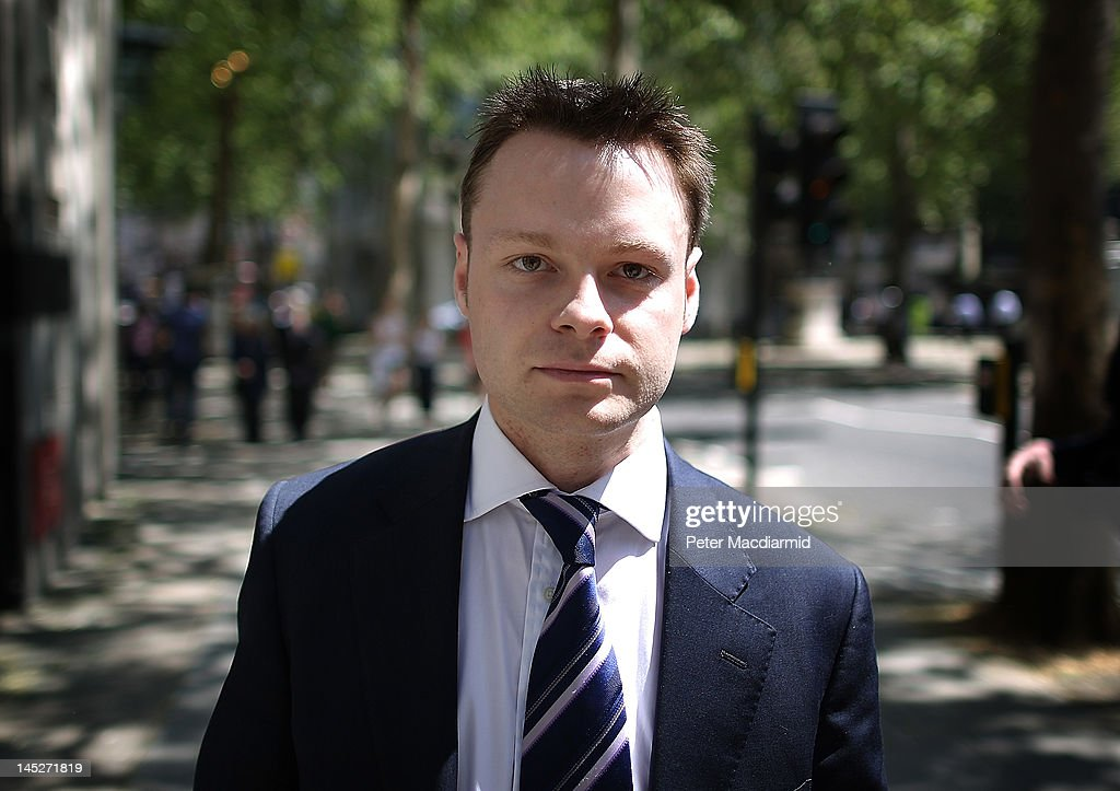 Adam Smith leaves The Royal Courts of Justice after giving evidence to The Leveson Inquiry for a second day on May 25 2012 in London England This...