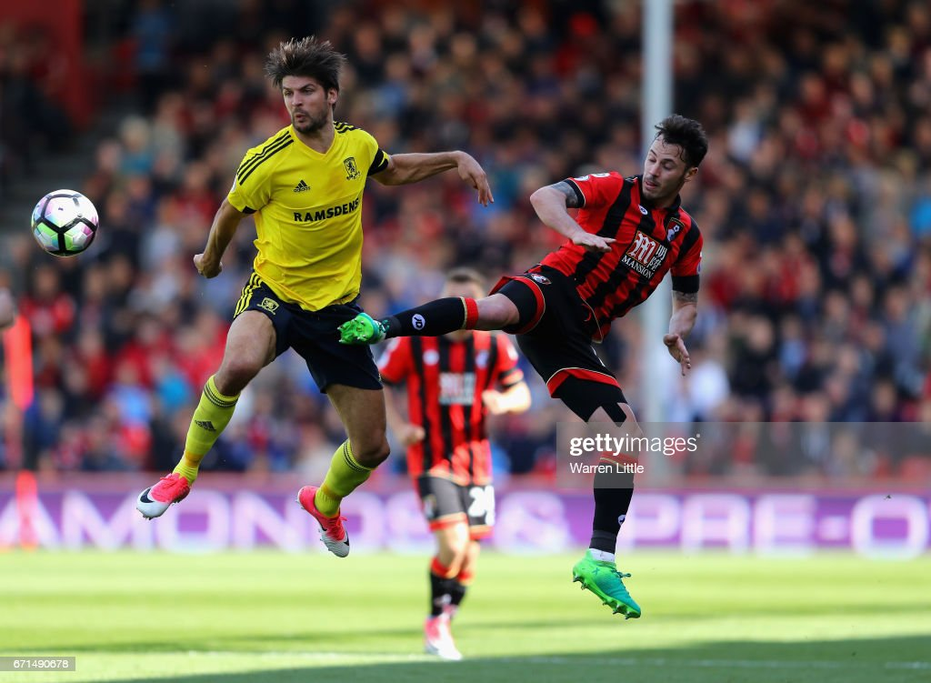 Adam Smith of AFC Bournemouth and George Friend of Middlesbrough in action during the Premier League match between AFC Bournemouth and Middlesbrough at the Vitality Stadium on April 22, 2017 in Bournemouth, England.