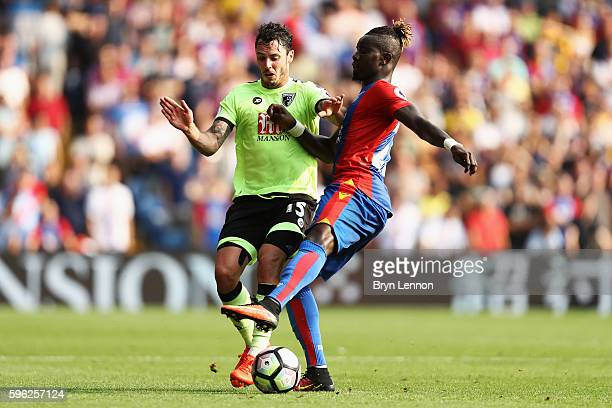 Adam Smith of AFC Bournemouth and Pape Souare of Crystal Palace battle for possession during the Premier League match between Crystal Palace and AFC...