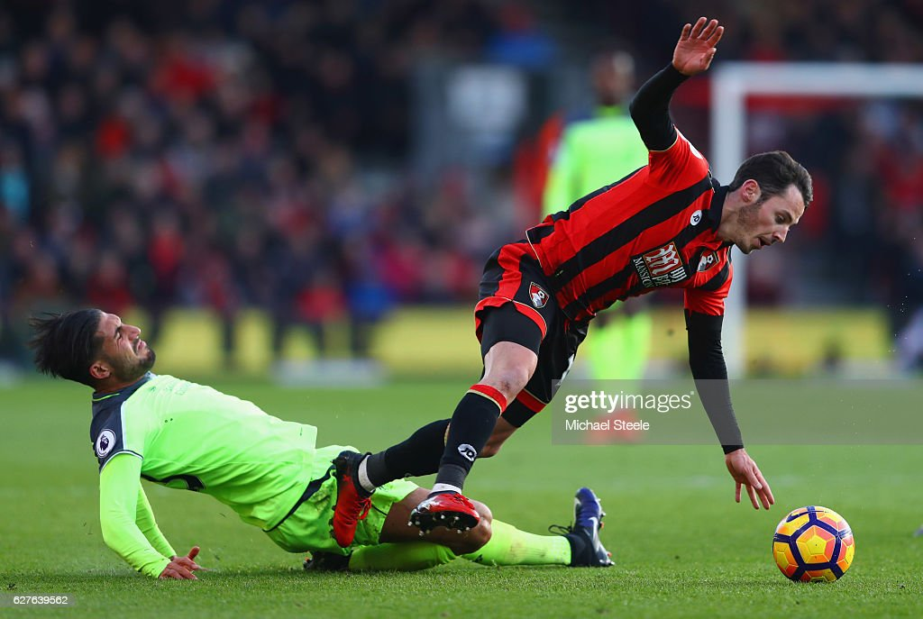 Adam Smith of AFC Bournemouth is tackled by Emre Can of Liverpool during the Premier League match between AFC Bournemouth and Liverpool at Vitality Stadium on December 4, 2016 in Bournemouth, England.