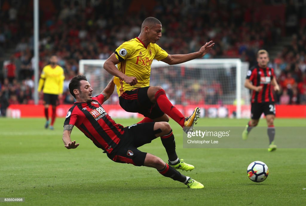 Adam Smith of AFC Bournemouth tackles Richarlison de Andrade of Watford during the Premier League match between AFC Bournemouth and Watford at Vitality Stadium on August 19, 2017 in Bournemouth, England.