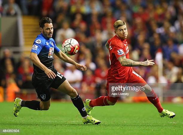 Adam Smith of Bournemouth and Alberto Moreno of Liverpool chase the ball during the Barclays Premier League match between Liverpool and AFC...