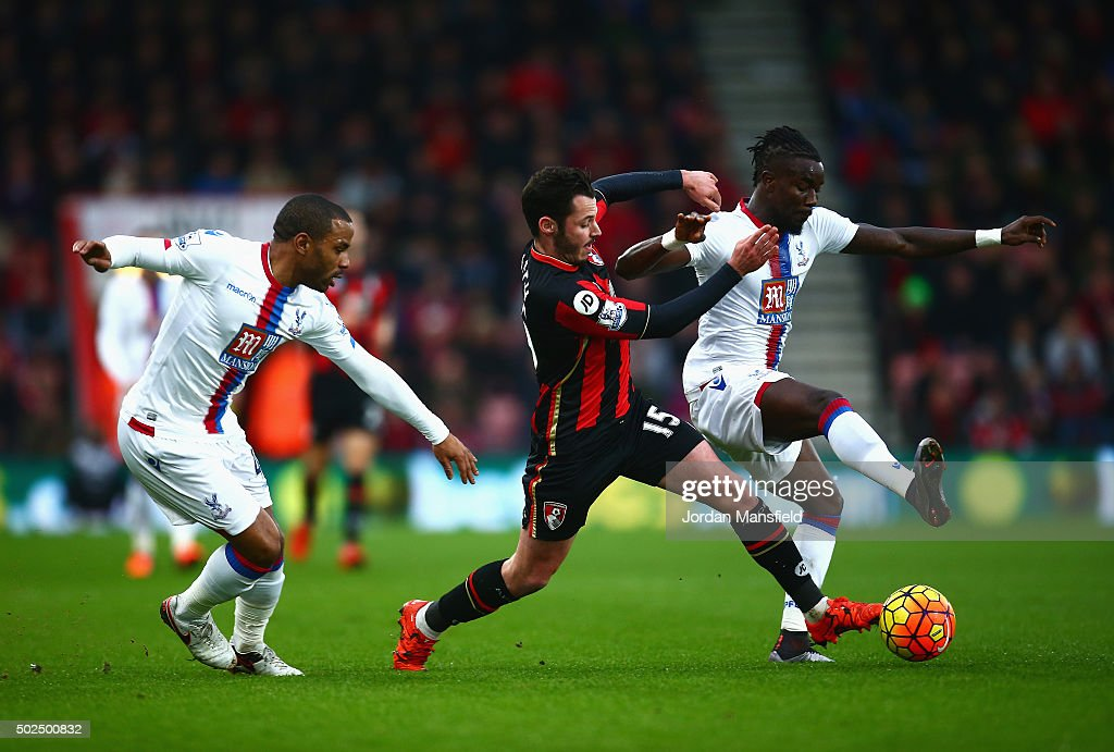 Adam Smith of Bournemouth challenges Pape Souare of Crystal Palace during the Barclays Premier League match between A.F.C. Bournemouth and Crystal Palace at Vitality Stadium on December 26, 2015 in Bournemouth, England.
