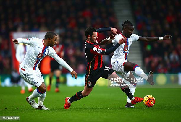Adam Smith of Bournemouth challenges Pape Souare of Crystal Palace during the Barclays Premier League match between AFC Bournemouth and Crystal...