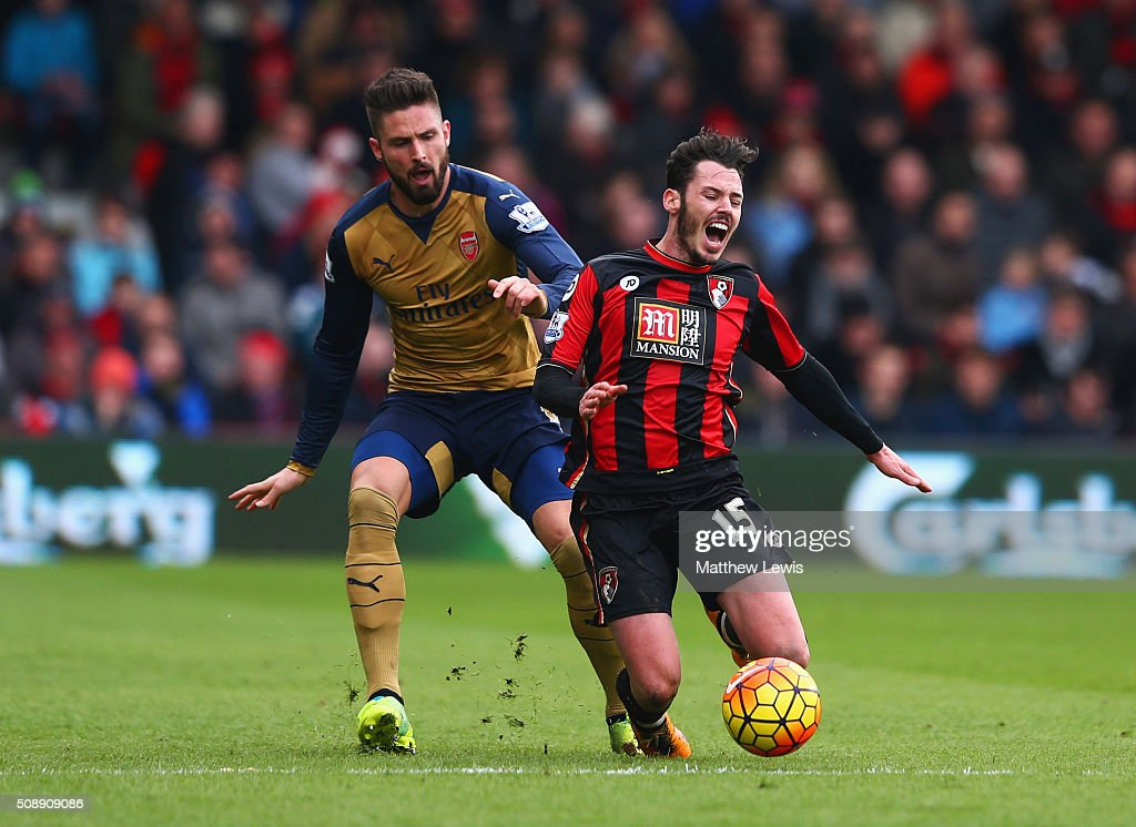 Adam Smith of Bournemouth is challenged by Olivier Giroud of Arsenal during the Barclays Premier League match between A.F.C. Bournemouth and Arsenal at the Vitality Stadium on February 7, 2016 in Bournemouth, England.