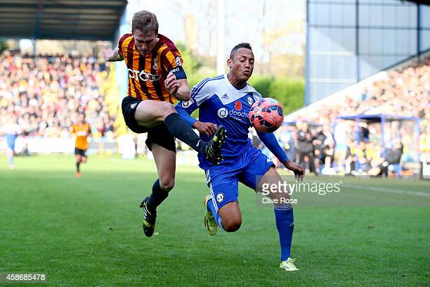 Adam Smith of Halifax Town is challenged by Stephen Darby of Bradford City during the FA Cup First Round match between FC Halifax and Bradford City...