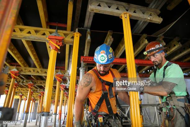 Adam Spencer left and Nick Zachary right of GC Concrete Construction Inc install reshore jacks at One Dalton Street in Boston Aug 17 2017 The 65story...