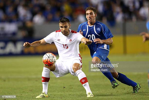 Adam Straith of Canada battles for the ball with Pablo Punyed of El Salvador in their CONCACAF Gold Cup Group B match at StubHub Center on July 8...