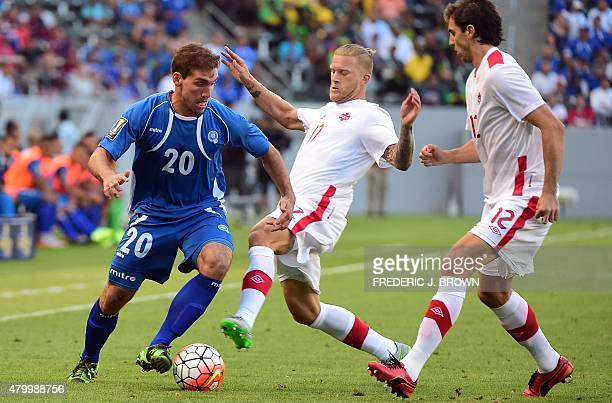 Adam Straith of Canada vies for the ball with Darwin Ceren of El Salvador during their 2015 Concacaf Gold Cup match in Carson California on July 8...