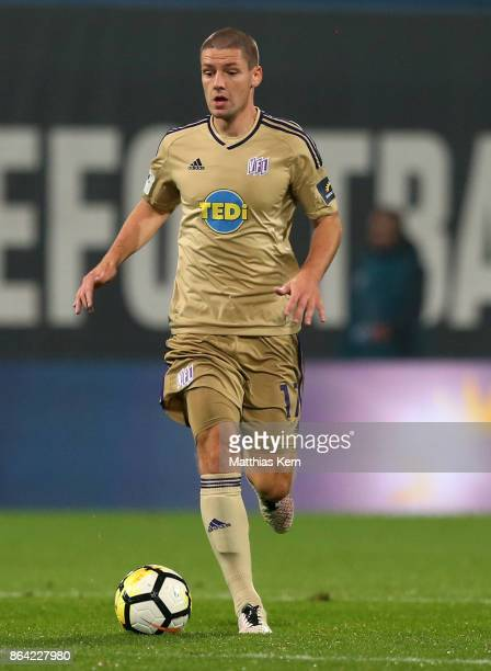 Adam Susac of Osnabrueck runs with the ball during the third league match between FC Hansa Rostock and VfL Osnabrueck at Ostseestadion on October 20...