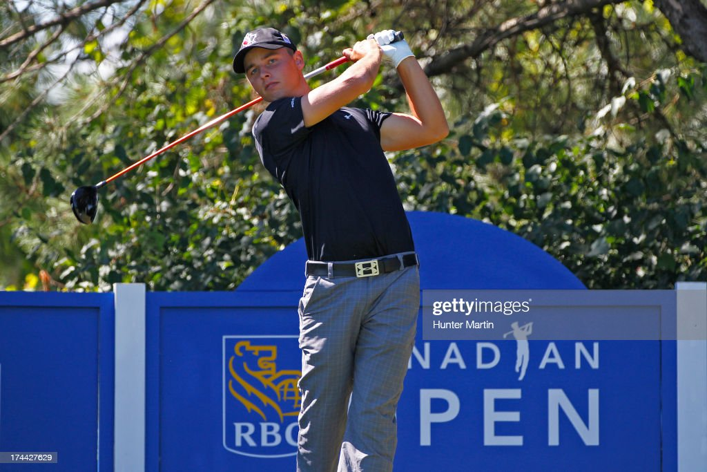Adam Svensson hits his tee shot on the 16th hole during round one of the RBC Canadian Open at Glen Abby Golf Club on July 25, 2013 in Oakville, Ontario.