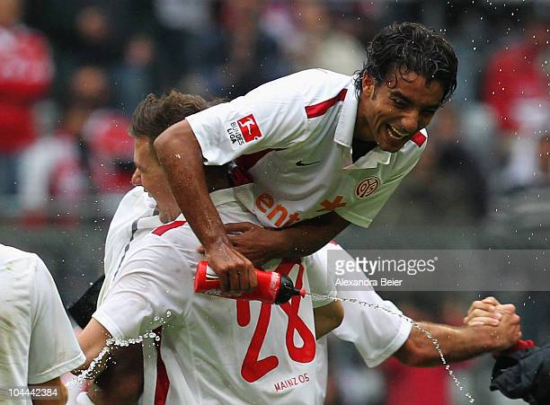 Adam Szalai and Sami Allagui of Mainz celebrate their victory of the Bundesliga first league match between FC Bayern Muenchen and FSV Mainz 05 at...