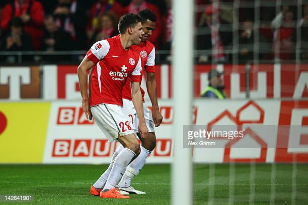 Adam Szalai celebrates his team's fourth goal with team mate Eric Maxim ChoupoMoting during the Bundesliga match between between FSV Mainz 05 and 1...
