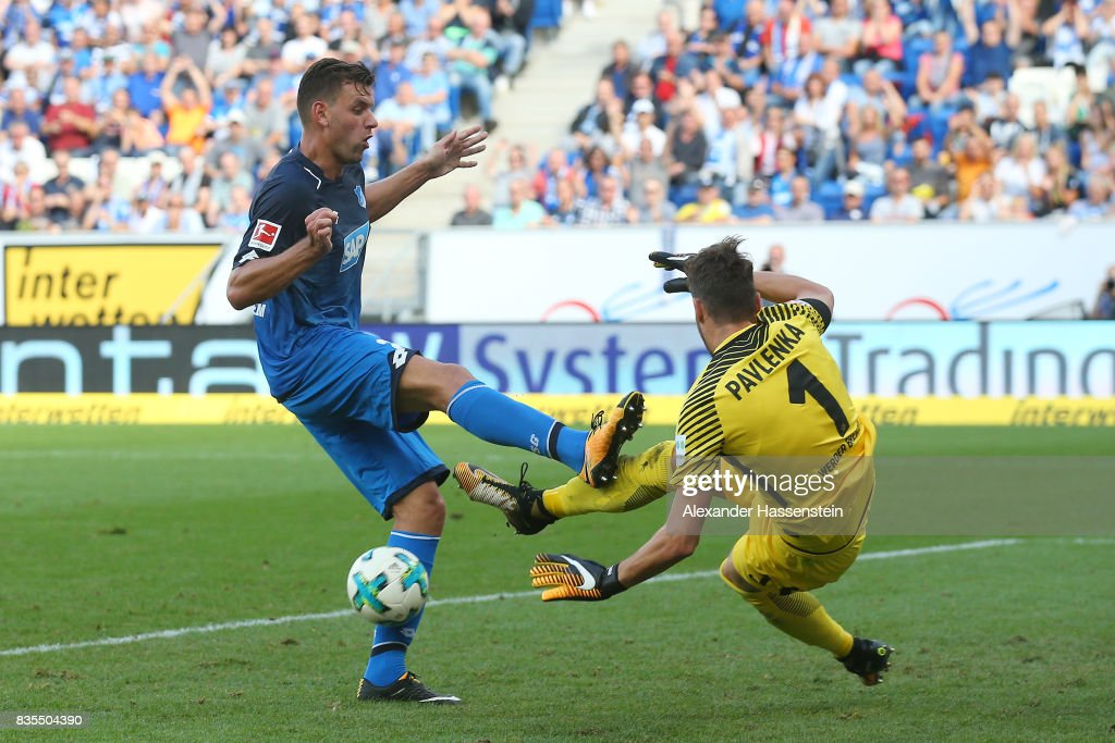Adam Szalai of Hoffenheim (l) and Jiri Pavlenka of Werder Bremen during the Bundesliga match between TSG 1899 Hoffenheim and SV Werder Bremen at Wirsol Rhein-Neckar-Arena on August 19, 2017 in Sinsheim, Germany.