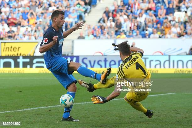 Adam Szalai of Hoffenheim and Jiri Pavlenka of Werder Bremen during the Bundesliga match between TSG 1899 Hoffenheim and SV Werder Bremen at Wirsol...