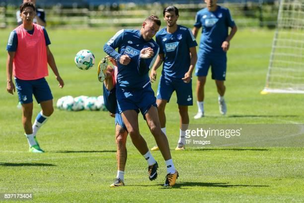 Adam Szalai of Hoffenheim and Steven Zuber of Hoffenheim battle for the ball during the Training Camp of TSG 1899 Hoffenheim on July 16 2017 in...