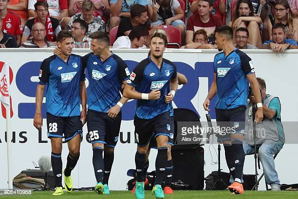 Adam Szalai of Hoffenheim celebrates his team's fourth goal with team mates during the Bundesliga match between 1 FSV Mainz 05 and TSG 1899...