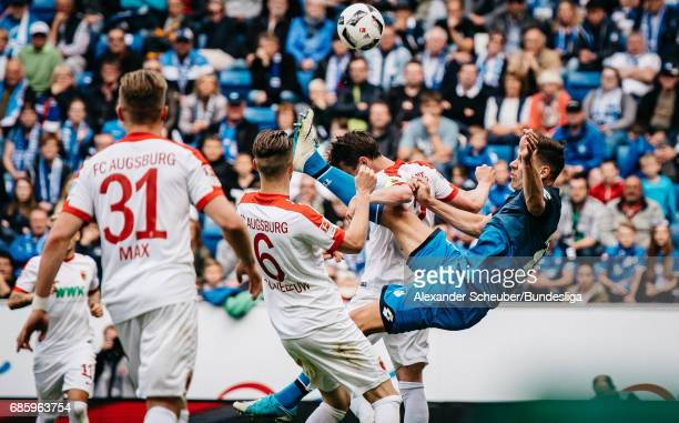 Adam Szalai of Hoffenheim in action against Jeffrey Gouweleeuw of Augsburg during the Bundesliga match between TSG 1899 Hoffenheim and FC Augsburg at...