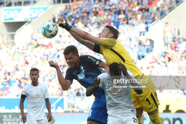 Adam Szalai of Hoffenheim Lamine Sane of Werder Bremen and Jiri Pavlenka of Werder Bremen during the Bundesliga match between TSG 1899 Hoffenheim and...