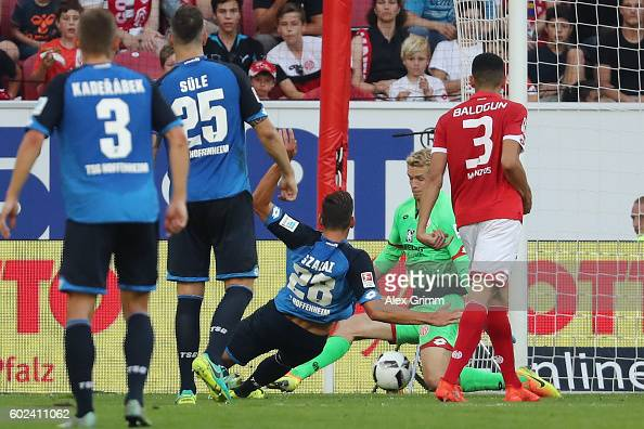 Adam Szalai of Hoffenheim scores his team's fourth goal against goalkeeper Jonas Loessl of Mainz during the Bundesliga match between 1 FSV Mainz 05...
