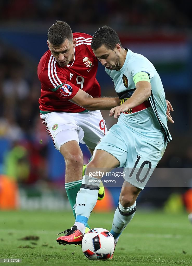 Adam Szalai (9) of Hungary in action against Eden Hazard (10) of Belgium during the UEFA Euro 2016 round of 16 football match between Hungary and Belgium at Stadium Municipal in Toulouse, France on June 26, 2016.