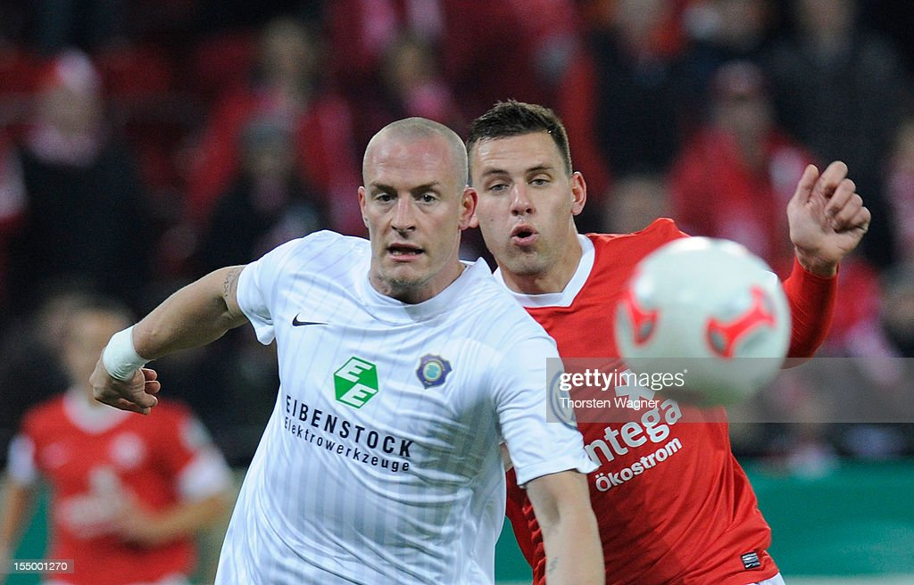 <a gi-track='captionPersonalityLinkClicked' href=/galleries/search?phrase=Adam+Szalai&family=editorial&specificpeople=2344504 ng-click='$event.stopPropagation()'>Adam Szalai</a> (R) of Mainz battles for the ball with Tobias Nickenig (L) of Aue during the DFB Cup second round match between FSV Mainz 05 and FC Erzgebirge Aue at Coface Arena on October 30, 2012 in Mainz, Germany.