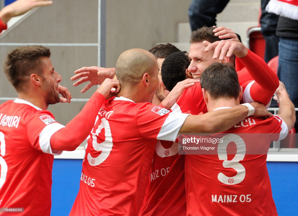 <a gi-track='captionPersonalityLinkClicked' href=/galleries/search?phrase=Adam+Szalai&family=editorial&specificpeople=2344504 ng-click='$event.stopPropagation()'>Adam Szalai</a> of Mainz celebrates after scoring his teams first goal with team mates during the Bundesliga match between FSV Mainz 05 and TSG 1899 Hoffenheim at Coface Arena on October 27, 2012 in Mainz, Germany.