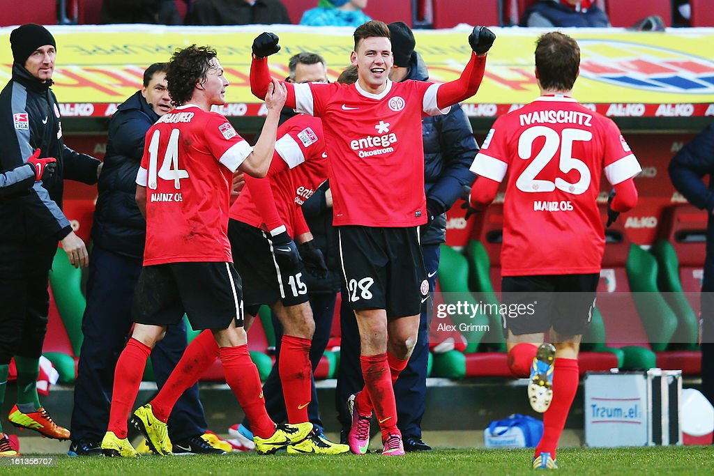 <a gi-track='captionPersonalityLinkClicked' href=/galleries/search?phrase=Adam+Szalai&family=editorial&specificpeople=2344504 ng-click='$event.stopPropagation()'>Adam Szalai</a> (C) of Mainz celebrates his team's first goal with team mates Julian Baumgartlinger (L) and <a gi-track='captionPersonalityLinkClicked' href=/galleries/search?phrase=Andreas+Ivanschitz&family=editorial&specificpeople=2140350 ng-click='$event.stopPropagation()'>Andreas Ivanschitz</a> during the Bundesliga match between FC Augsburg and 1. FSV Mainz 05 at SGL Arena on February 10, 2013 in Augsburg, Germany.