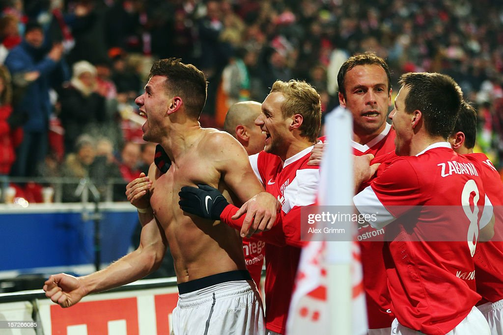 <a gi-track='captionPersonalityLinkClicked' href=/galleries/search?phrase=Adam+Szalai&family=editorial&specificpeople=2344504 ng-click='$event.stopPropagation()'>Adam Szalai</a> of Mainz celebrates his team's second goal with team mates during the Bundesliga match between 1. FSV Mainz 05 and Hannover 96 at Coface Arena on December 1, 2012 in Mainz, Germany.