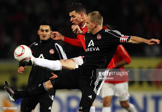 Adam Szalai of Mainz is challenged by Andreas Wolf of Nuernberg during the Bundesliga match between FSV Mainz 05 and 1 FC Nuernberg at Bruchweg...