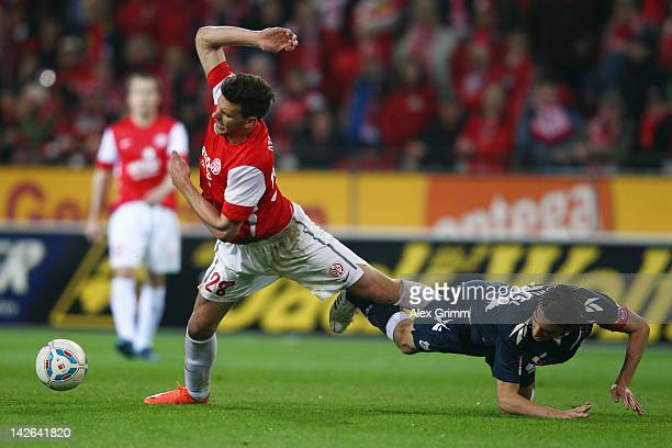 Adam Szalai of Mainz is challenged by Geromel of Koeln during the Bundesliga match between between FSV Mainz 05 and 1 FC Koeln at Coface Arena on...