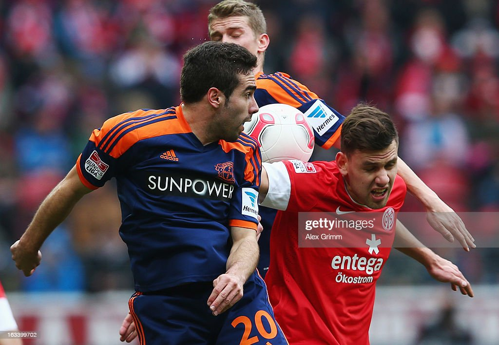<a gi-track='captionPersonalityLinkClicked' href=/galleries/search?phrase=Adam+Szalai&family=editorial&specificpeople=2344504 ng-click='$event.stopPropagation()'>Adam Szalai</a> (R) of Mainz is challenged by <a gi-track='captionPersonalityLinkClicked' href=/galleries/search?phrase=Lars+Bender&family=editorial&specificpeople=644948 ng-click='$event.stopPropagation()'>Lars Bender</a> (back) and Dani Carvajal (L) of Leverkusen during the Bundesliga match between 1. FSV Mainz 05 and Bayer 04 Leverkusen at Coface Arena on March 9, 2013 in Mainz, Germany.