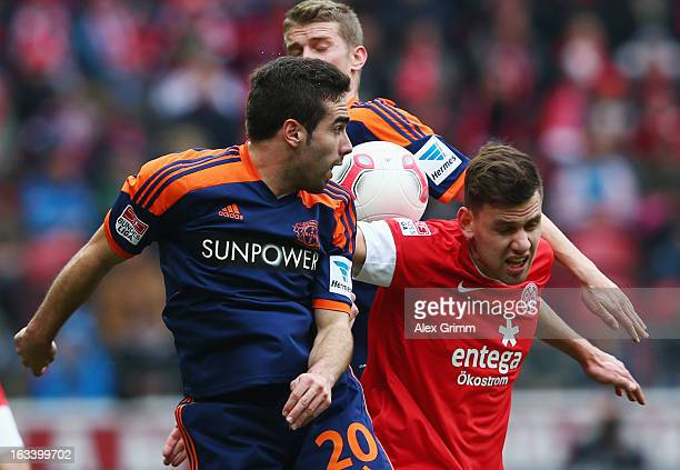 Adam Szalai of Mainz is challenged by Lars Bender and Dani Carvajal of Leverkusen during the Bundesliga match between 1 FSV Mainz 05 and Bayer 04...
