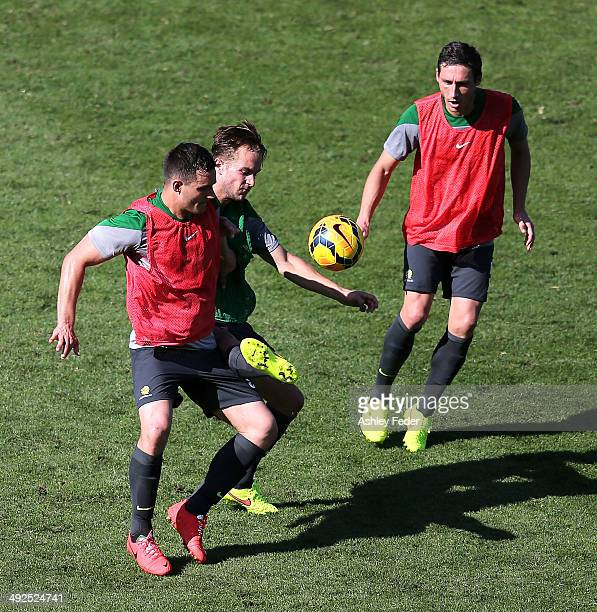 Adam Taggart and Mark Milligan contest the ball during an Australian Socceroos training session at Central Coast Stadium on May 21 2014 in Gosford...