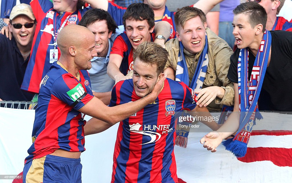 Adam Taggart and Ruben Zadkovic of the Jets celebrate a goal during the round seven A-League match between the Newcastle Jets and the Melbourne Heart at Hunter Stadium on November 24, 2013 in Newcastle, Australia.