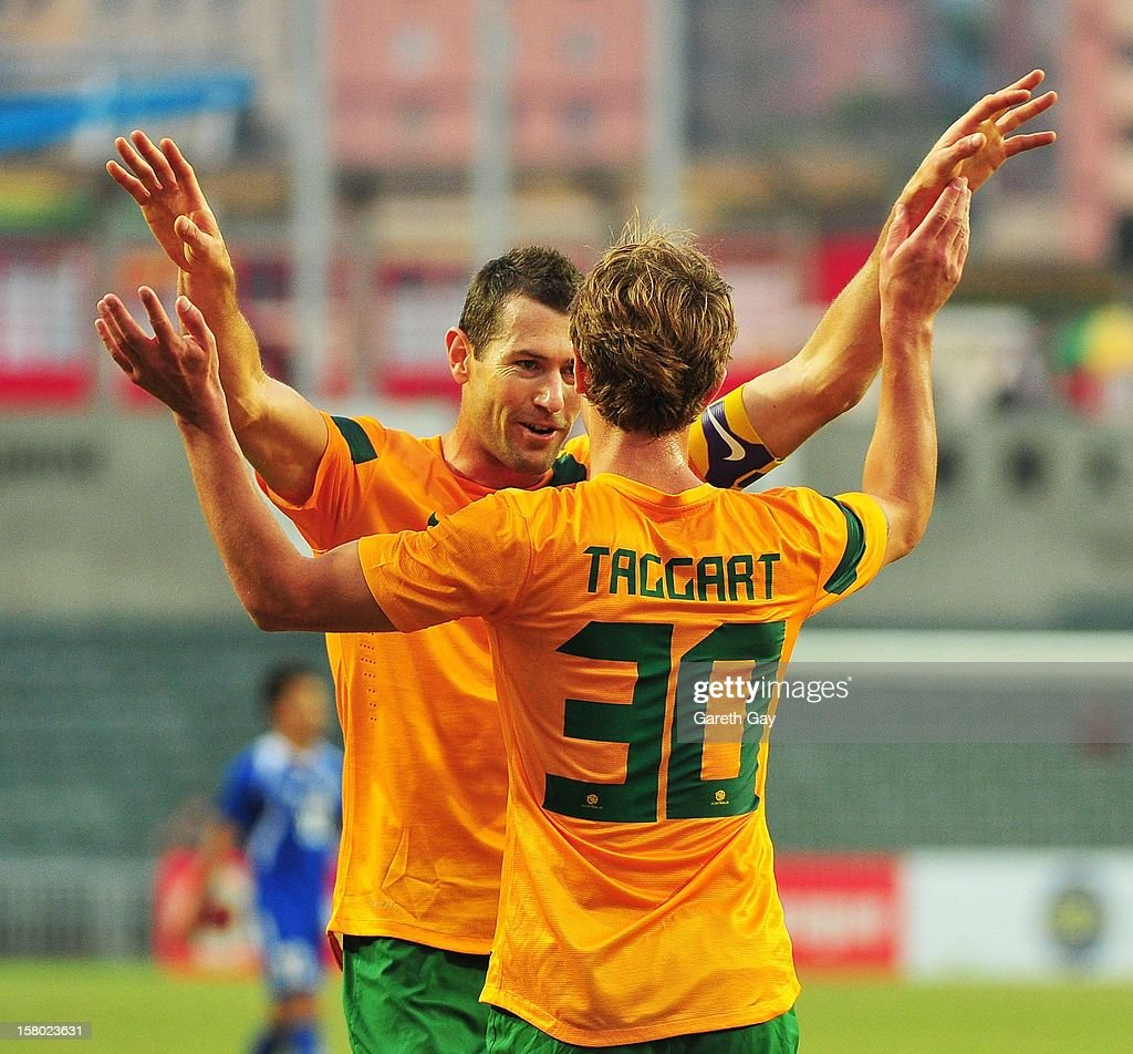 Adam Taggart of Australia celebrates a goal with captain Brett Emerton (L) of Australia during the EAFF East Asian Cup 2013 Qualifying match between Chinese Tapei and the Australian Socceroos at Hong Kong Stadium on December 9, 2012 in So Kon Po, Hong Kong.