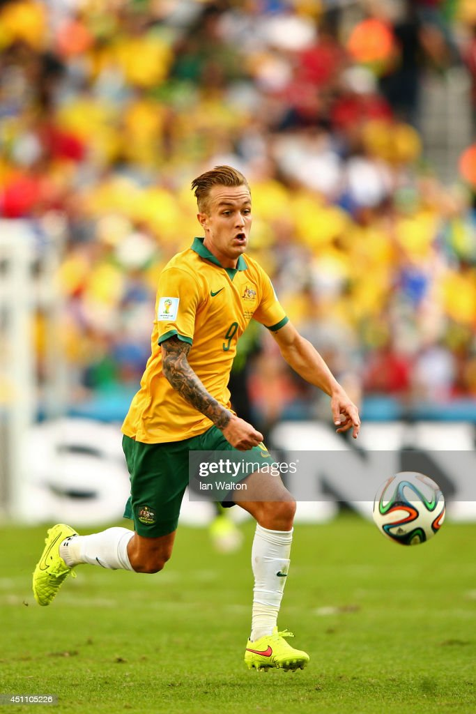 Adam Taggart of Australia controls the ball during the 2014 FIFA World Cup Brazil Group B match between Australia and Spain at Arena da Baixada on...