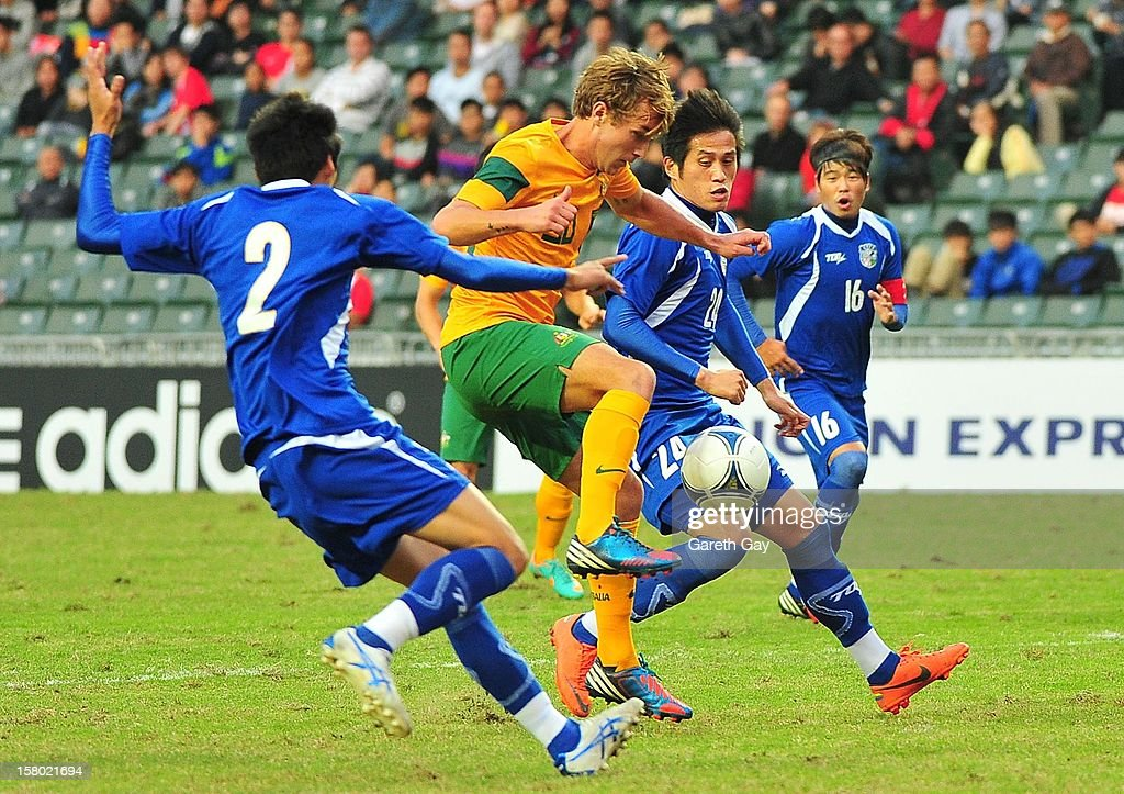 Adam Taggart (2nd L) of Australia controls the ball during the EAFF East Asian Cup 2013 Qualifying match between Chinese Tapei and the Australian Socceroos at Hong Kong Stadium on December 9, 2012 in So Kon Po, Hong Kong.